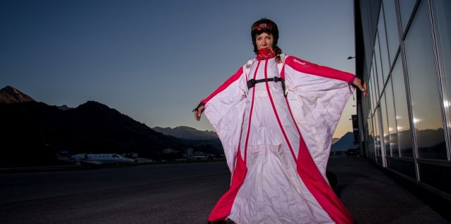 Wingsuit connected: Geraldine Fasnacht is flying with her illuminated wingsuit 5000 meters above the Swiss Alps