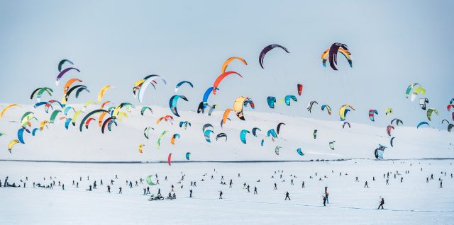 World's toughest snowkiting race fills frozen plateau with colour