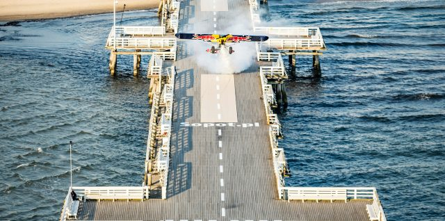 PHOTO ALERT: Pilot lands on iconic pier the same width as his plane